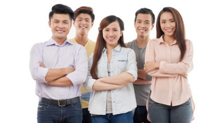 Cheerful young Vietnamese business team on white background